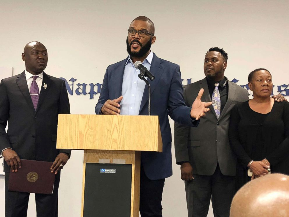 PHOTO: Filmmaker Tyler Perry, center, speaks to a a press conference announcing a lawsuit against former Collier County Sheriffs Deputy Steven Calkins, Sept. 4, 2018 in Naples, Fla.