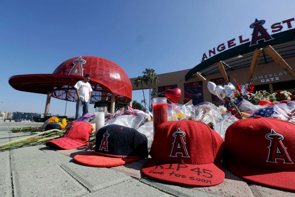 PHOTO: Angel Lozano looks over at a memorial as he give his condolences for Los Angeles Angels pitcher Tyler Skaggs outside Angel Stadium in Anaheim, Calif., on July 2, 2019.