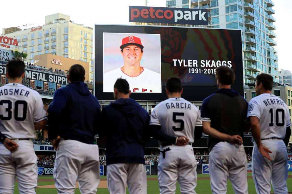 PHOTO: Players for the San Diego Padres and San Francisco Giants stand during a moment of silence for pitcher Tyler Skaggs of the Los Angeles Angels of Anaheim at PETCO Park on July 01, 2019, in San Diego.