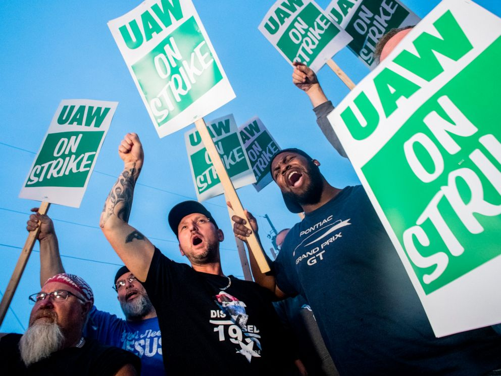 PHOTO: General Motors employees Bobby Caughel, left, and Flint resident James Crump, shout out as they protest with other GM employees, United Auto Workers members and labor supporters outside of the Flint Assembly Plant, Sept. 16, 2019 in Flint, Mich.