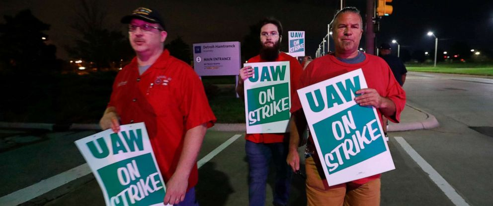 PHOTO: United Auto Workers members picket outside the General Motors Detroit-Hamtramck assembly plant in Hamtramck, Mich., early Monday, Sept. 16, 2019.