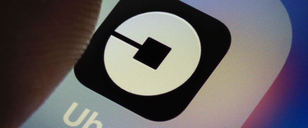 PHOTO: The Uber app logo is displayed on a smartphone on March 20, 2018 in Berlin.