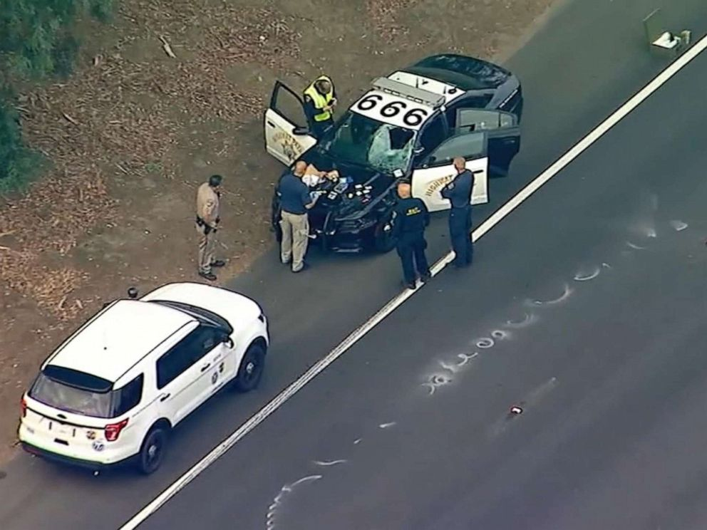PHOTO: Police at the scene in Encino, Calif., after an Uber passenger was fatally struck by patrol vehicle after jumping median and = running across Highway 101, Oct. 14, 2019.