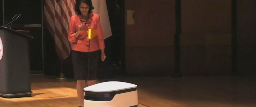 PHOTO: University of Houston President Renu Khator demonstrates an autonomous food delivery robot during her annual fall address, Sept. 2, 2019.