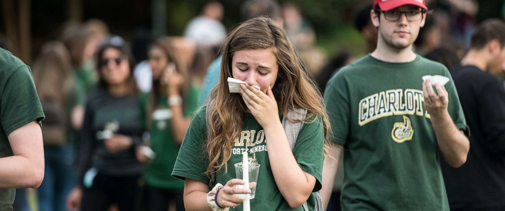PHOTO: A UNC Charlotte student participates in a vigil on campus where the previous day a gunman killed two people and injured four students on May 1, 2019 in Charlotte, N.C.