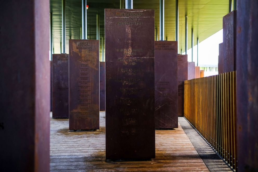 PHOTO: The suspended columns, made of rusted steel and inscribed with victims names, are organized by state and county, at The National Memorial for Peace and Justice in Montgomery, Ala.