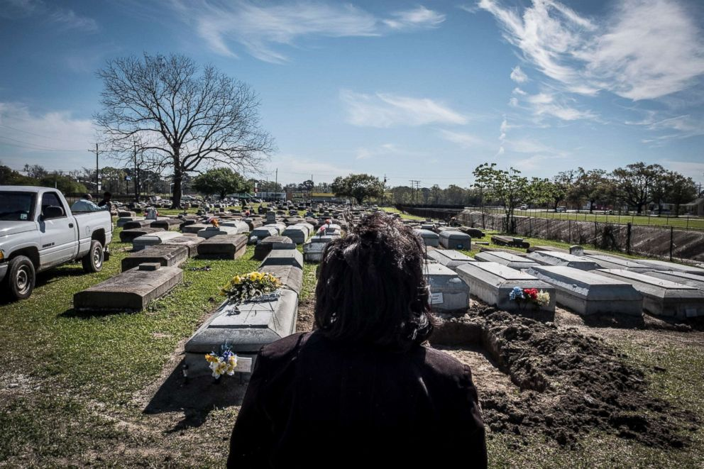 PHOTO: The author, Karin Berry, searches for the grave of Estelle Nickerson, Charles Browns only daughter, who was buried at this cemetery in East Feliciana Parish in 1951.