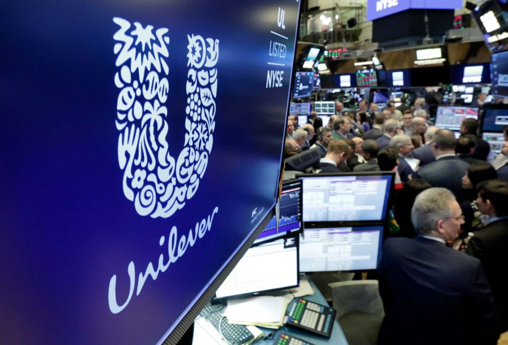 PHOTO: The logo for Unilever appears above a trading post on the floor of the New York Stock Exchange, March 15, 2018. Consumer products giant Unilever said they are pledging to halve its use of non-recycled plastics by 2025.