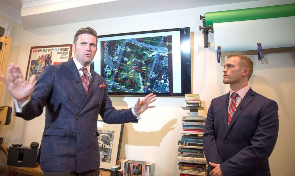 PHOTO: White nationalist Richard Spencer (L) and Nathan Damigo of Identity Evropa speak to select media in a building serving as office space, Aug. 14, 2017 in Alexandria, Va.
