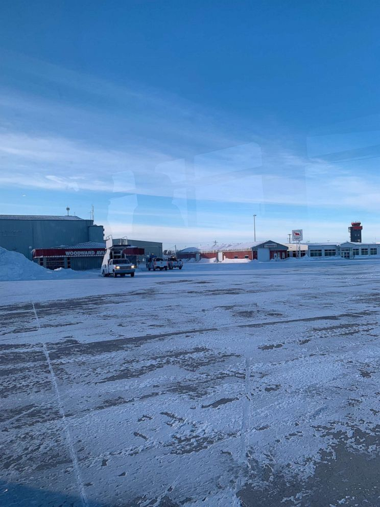 PHOTO: Medical personnel met the plane in Goose Bay, Newfoundland, where a sick passenger was brought to a nearby hospital. January 20, 2019.