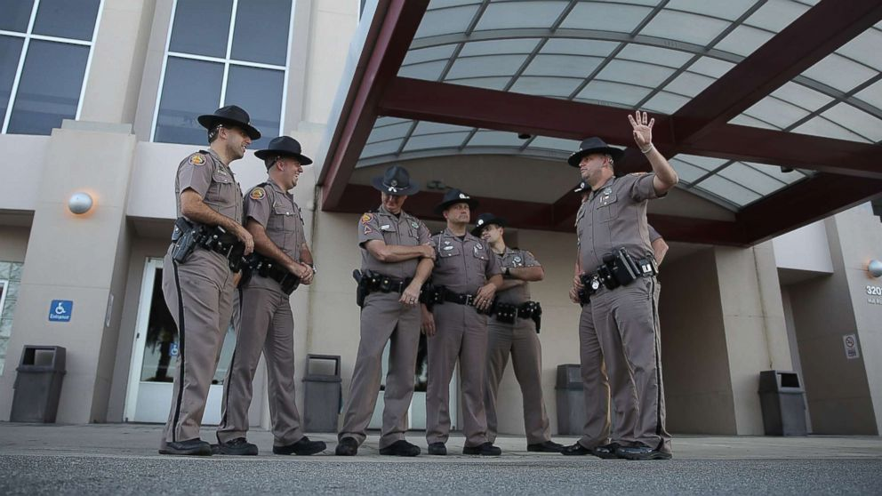 Florida Highway Patrol officers stand outside the Curtis M. Phillips Center for the Performing Arts as they prepare the venue for Thursday's scheduled speech by white nationalist Richard Spencer on Oct. 18, 2017 in Gainesville, Fla.