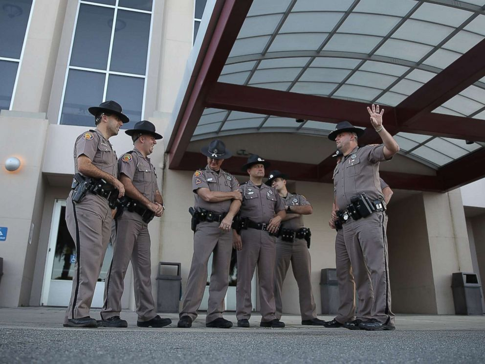 PHOTO: Florida Highway Patrol officers stand outside the Curtis M. Phillips Center for the Performing Arts as they prepare the venue for Thursdays scheduled speech by white nationalist Richard Spencer on Oct. 18, 2017 in Gainesville, Fla.