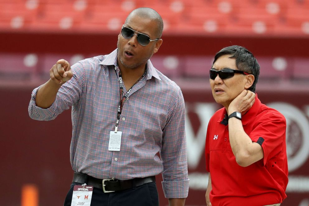 PHOTO: University of Maryland athletic director Damon Evans (L) and university president Wallace Loh watch pregame before the start of the Maryland Terrapins and Texas Longhorns game at FedExField, Sept. 1, 2018, in Landover, Md.