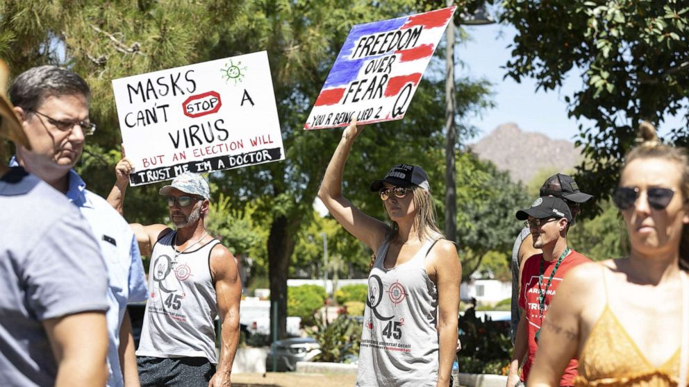 Officials see pushback as more states, counties require people to wear masks in public thumbnail