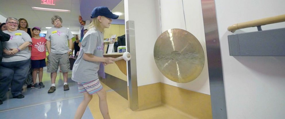PHOTO: Patients in the Radiation Oncology Department at UPMC Childrens Hospital of Pittsburgh celebrate the end of their treatment by striking a gong.