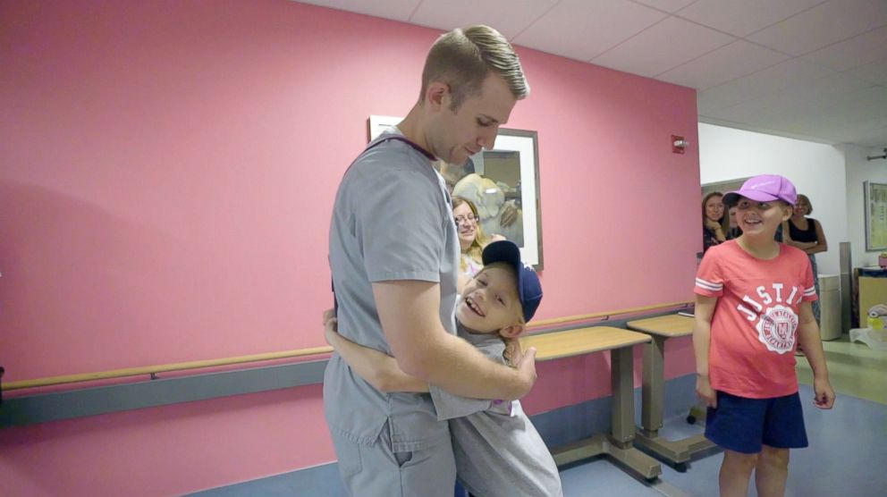 PHOTO: Kaylee Kruise hugs her radiation therapist at UPMC Childrens Hospital of Pittsburgh.