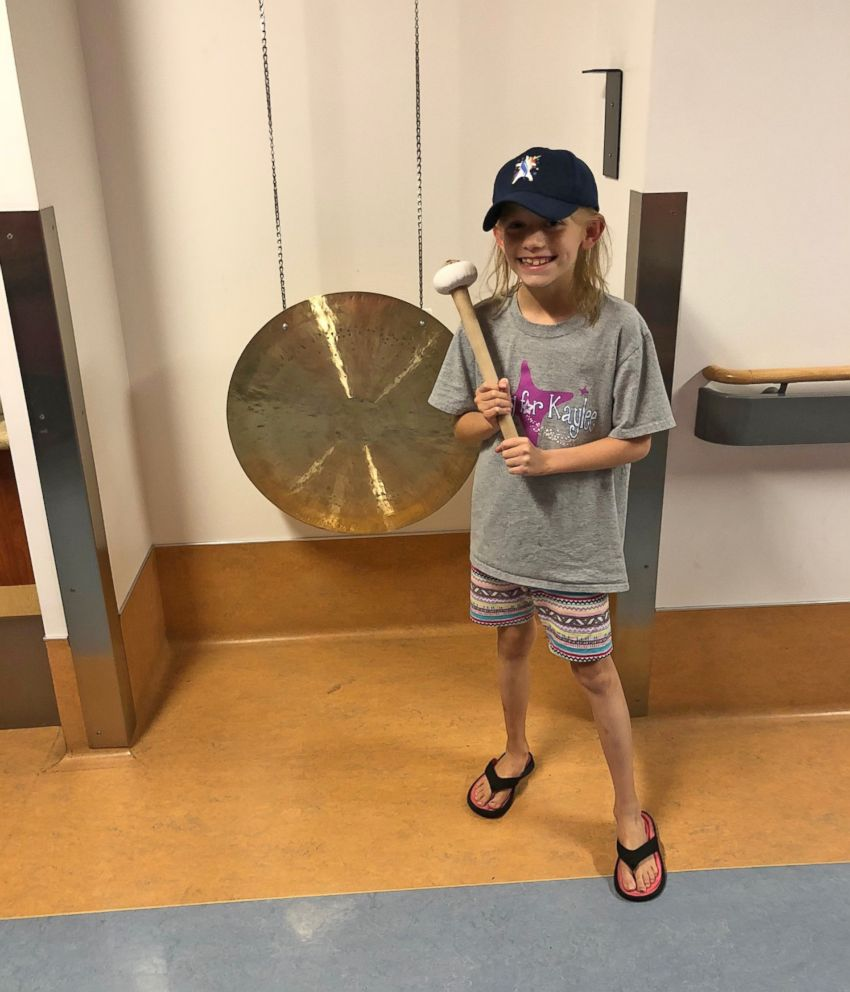 PHOTO: Kaylee Kruise stands in front of the gong at UPMC Childrens Hospital of Pittsburgh.