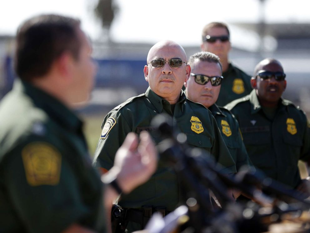 PHOTO: Roy Villarreal, acting Chief Patrol Agent of the Border Patrol, San Diego Sector, left, speaks to other Border Patrol agents on in front of secondary fencing along the border separating San Diego from Tijuana, Mexico, Sept. 26, 2017, in San Diego.