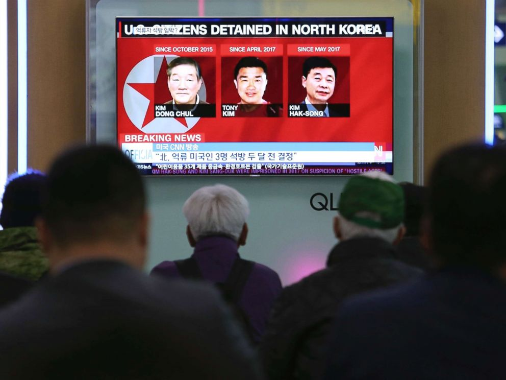 PHOTO: People watch a TV news report showing portraits of three Americans, Kim Dong-chul, left, Tony Kim (also known as Kim Sang-duk) and Kim Hak-song, right, detained in the North Korea at the Seoul Railway Station in Seoul, South Korea, May 3, 2018.