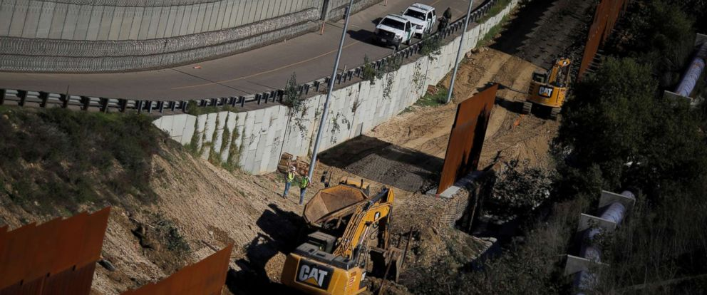 PHOTO: Workers are seen next a construction site of the border fence between United States and Mexico, seen from Tijuana, Mexico, Dec. 19, 2018.