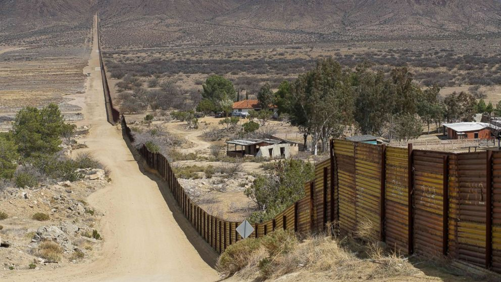 """Houses are seen on the Mexican side of the U.S.-Mexico border fence on April 6, 2018 in Jacumba, Calif. President Donald Trump on April 5, 2018 said he would send thousands of National Guard troops to the southern border, amid a widening spat with his Mexican counterpart Enrique Pena Nieto. The president said the National Guard deployment would range from 2,000 to 4,000 troops, and he would """"probably"""" keep many personnel on the border until his wall is built -- spelling out a lengthy mission."""
