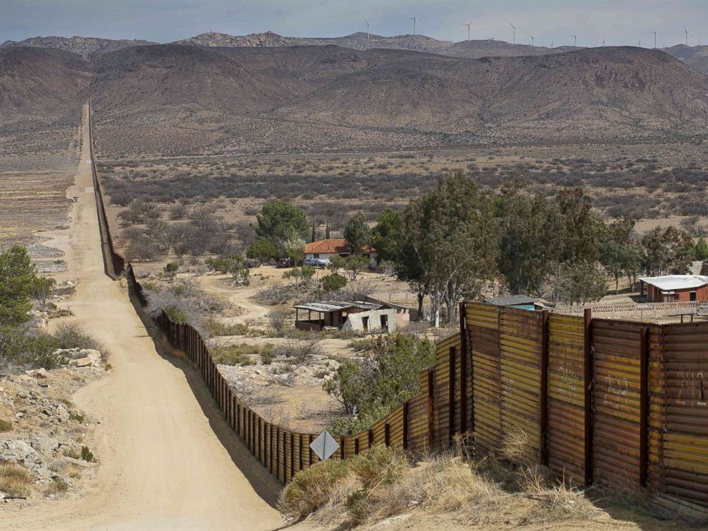 PHOTO: Houses are seen on the Mexican side of the U.S.-Mexico border fence on April 6, 2018 in Jacumba, Calif.