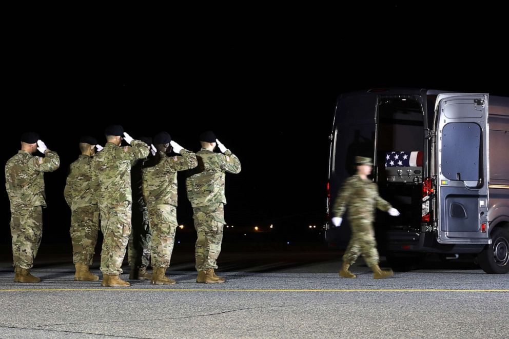 PHOTO: A U.S. Army carry team salutes after loading the remains of U.S. Army Sgt. Maj. James G. Sartor into a mortuary van during a dignified transfer at Dover Air Force Base, July 15, 2019, in Dover, Delaware.