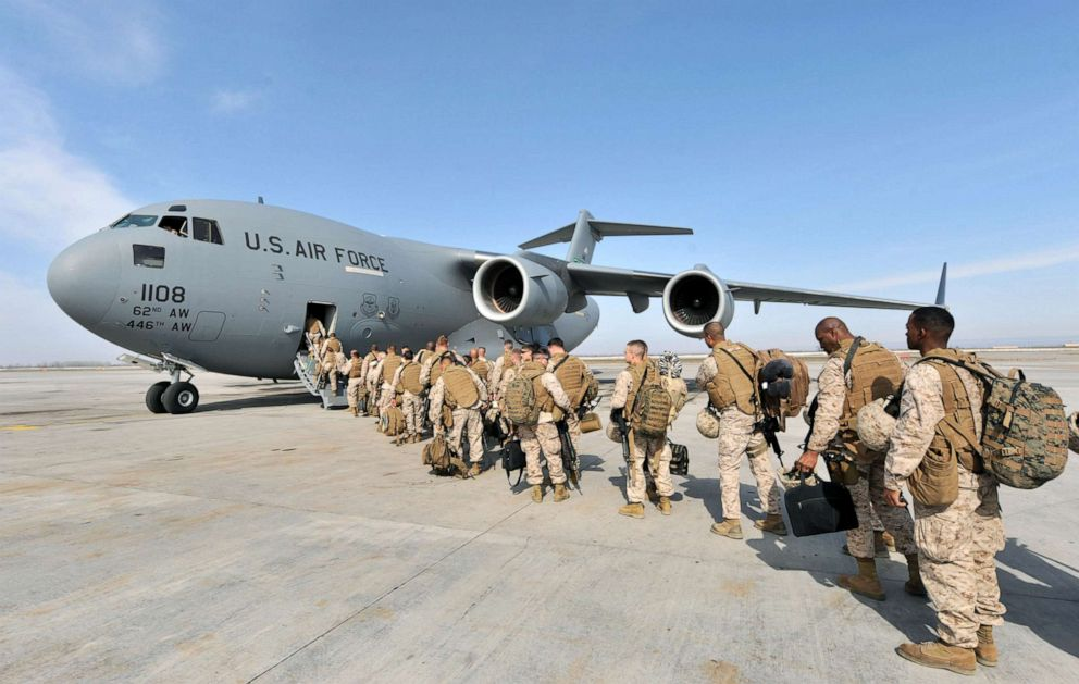 PHOTO: US Soldiers from the 1st Marine Expeditionary Force Pendleton camp bound for Helmand, Afghanistan board their flight at the Manas Transit Center, March 6, 2010.