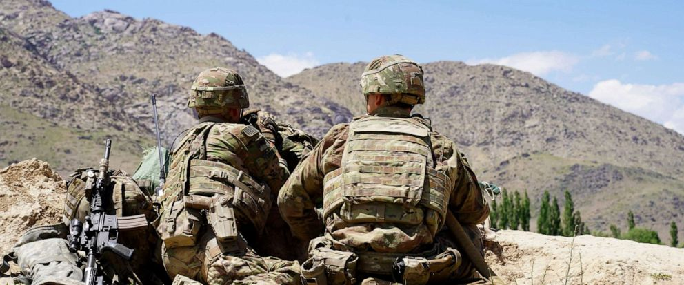 PHOTO: US soldiers look out over hillsides at the Afghan National Army (ANA) checkpoint in Nerkh, Afghanistan, June 6, 2019.