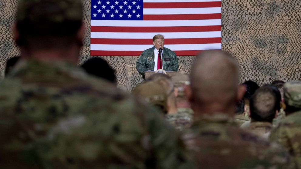 President Donald Trump speaks to members of the military at a hangar rally at Al Asad Air Base, Iraq, Dec. 26, 2018.