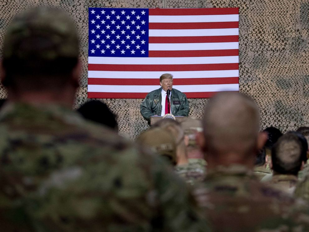 PHOTO: President Donald Trump speaks to members of the military at a hangar rally at Al Asad Air Base, Iraq, Dec. 26, 2018.