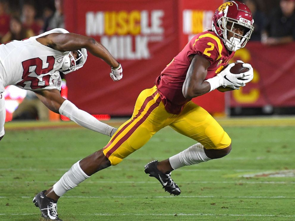 PHOTO: Wide receiver Devon Williams of the USC Trojans holds on to pass as he breaks loose from cornerback Obi Eboh of the Stanford Cardinal for a first down in the first half of the game on September 7, 2019, in Los Angeles.
