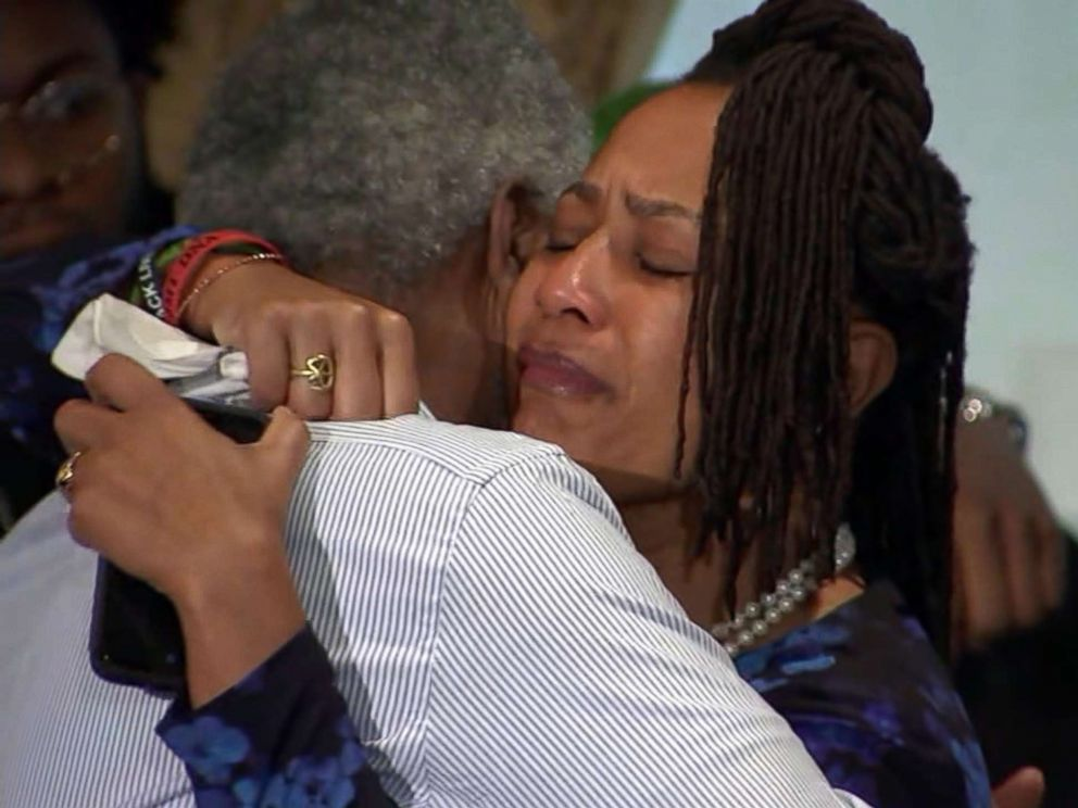 PHOTO: Oakland City Councilwoman Lynette Gibson McElhaney hugs her husband after speaking at a press conference on March 12, 2019, about the death of her son, Victor McElhaney, 21, who was killed during an attempted robbery.