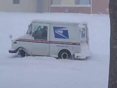 WATCH:  USPS driver battles snowy street in Nebraska
