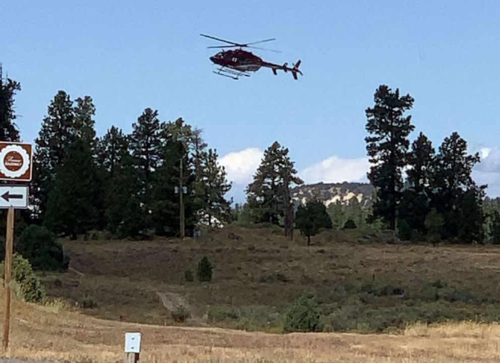 PHOTO: A helicopter flies near the scene where a tour bus crashed near Bryce Canyon National Park on SR-12 in Utah, Sept. 20, 2019.