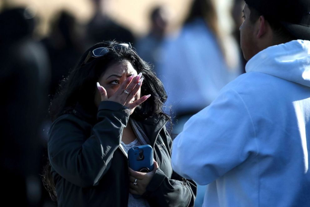 PHOTO: Evelyn Salazar Atwood wipes tears from her eyes after reuniting with her son, Chris Salazar, who works at Fashion Place Mall, after a shooting at the mall in Murray, Utah, Jan. 13, 2019.