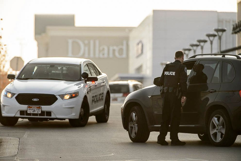 PHOTO: Police escort employees from Dillards out of the Fashion Place mall after a shooting in Murray, Utah, Jan. 13, 2019.
