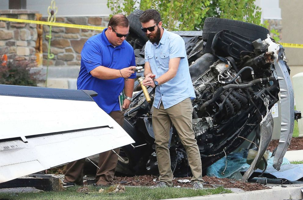 PHOTO: Federal Aviation Administration officials investigate the scene of a plane crash in Payson, Utah, Aug. 13, 2018.