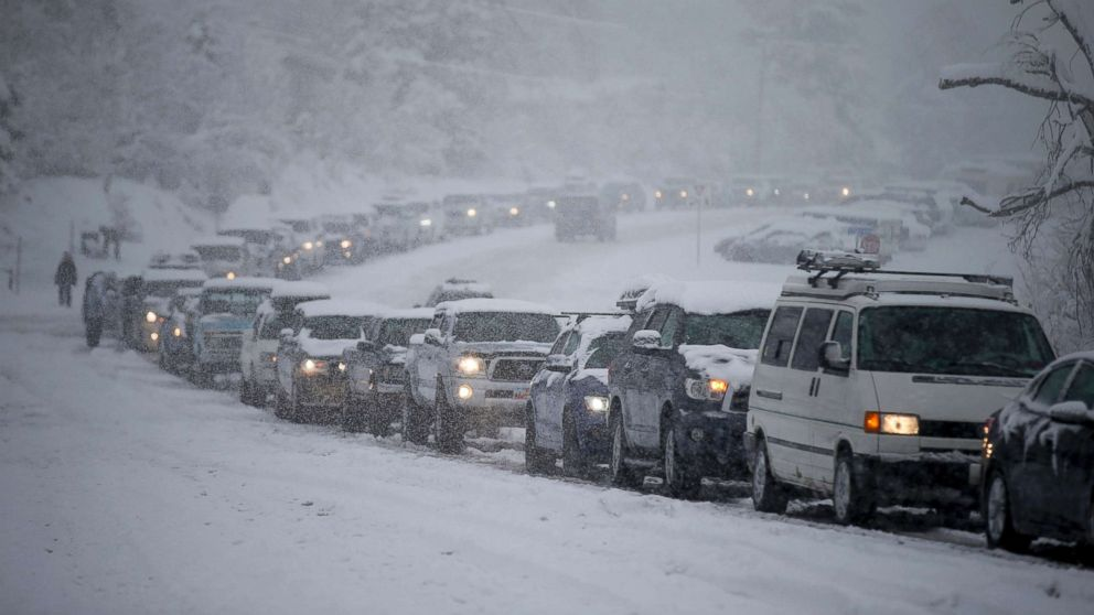 Traffic is backed up in all directions at the mouth of Big Cottonwood Canyon, west of Salt Lake City, as the canyon experiences intermittent closures during a winter storm, Jan. 21, 2019.