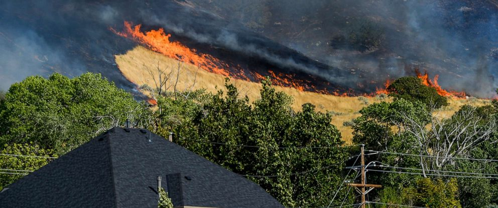 PHOTO: A wildfire spreads along the mountainside, Sept. 16, 2019, in Kaysville, Utah, threatening structures and forcing evacuations as it moves east.