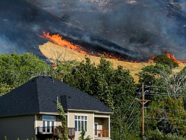 Wildfires spread in the West flash flooding forecast in Texas