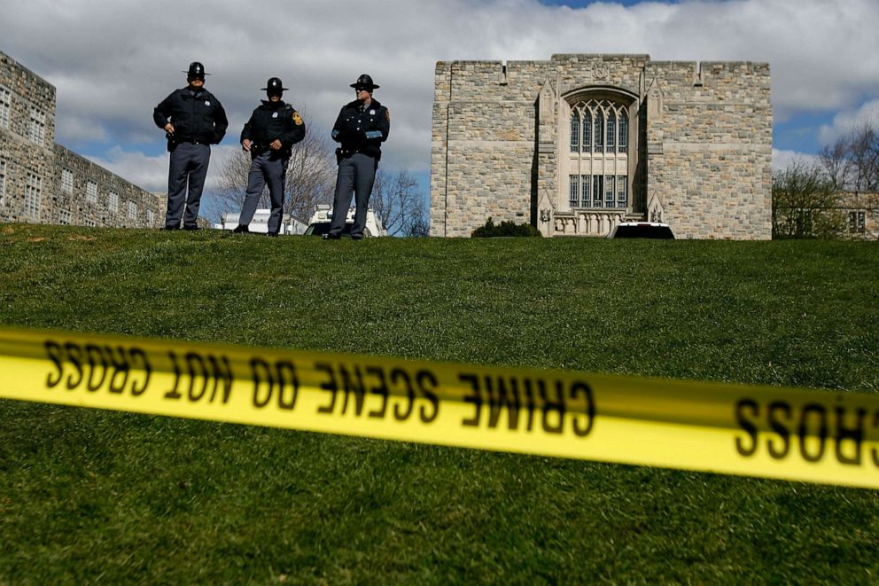 PHOTO: Virginia State Police stand guard outside Norris Hall, where 31 people were shot and killed a day earlier on the campus of Virginia Tech, April 17, 2007 in Blacksburg, Va.