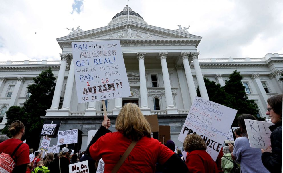 PHOTO: Demonstrators protest against a measure requiring California schoolchildren to get vaccinated, at a rally in Sacramento, Calif., April 8, 2015.