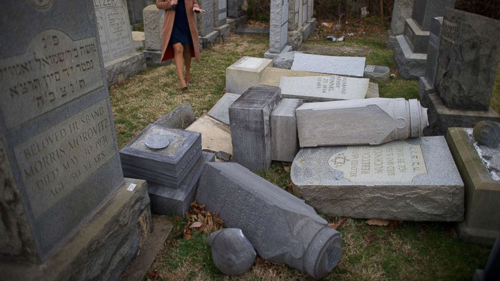 A television reporter broadcasts in front of vandalized Jewish tombstones at Mount Carmel Cemetery Feb. 27, 2017 in Philadelphia.