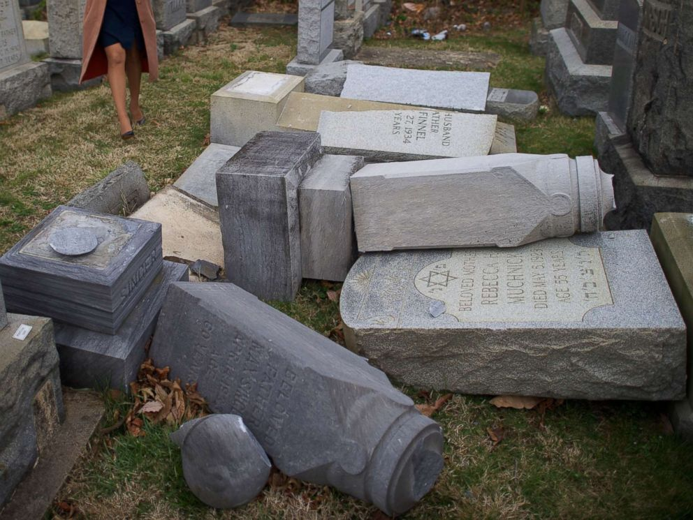 PHOTO: A television reporter broadcasts in front of vandalized Jewish tombstones at Mount Carmel Cemetery Feb. 27, 2017 in Philadelphia.