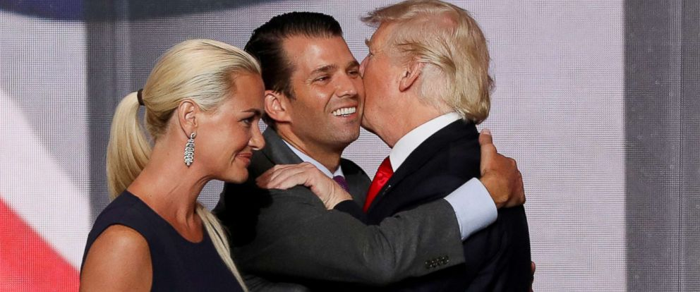 PHOTO: Donald Trump Jr. hugs his father, Presidential candidate Donald Trump, as Donald Jrs wife Vanessa walks past after Trump accepted the Republican presidential nomination at the 2016 Republican National Convention in Cleveland, July 21, 2016.