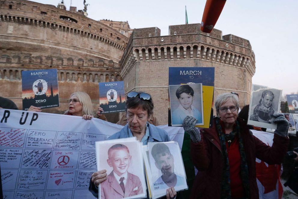PHOTO: People hold up pictures of what they claim to be victims of priests sexual abuse as they gather during a twilight vigil prayer near Castle Sant Angelo, in Rome, Feb. 21, 2019.