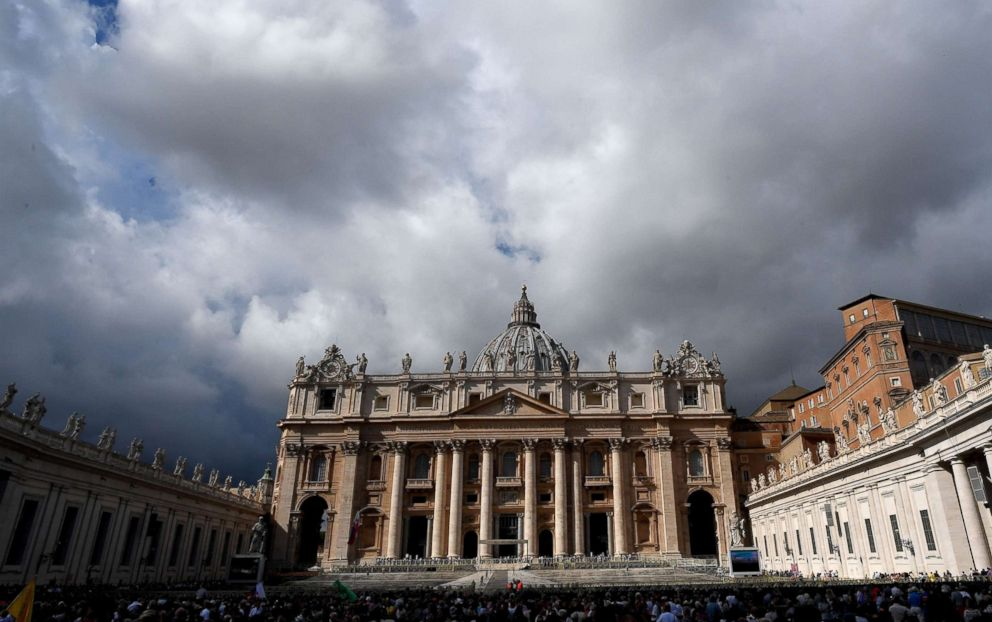 People gather in St. Peter's Square as Pope Francis recites the Angelus noon prayer from the window of his studio at the Vatican, Oct. 7, 2018.