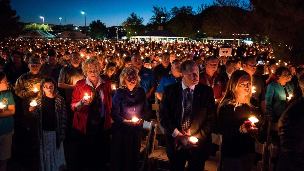 Las Vegas Mayor Carolyn Goodman and a large crowd of people hold candles at a memorial service for Charleston Hartfield, a Las Vegas police officer who was killed on Oct. 1, 2017 when a gunman opened fire on a county music festival, in Las Vegas, Nevada, Oct. 5, 2017.