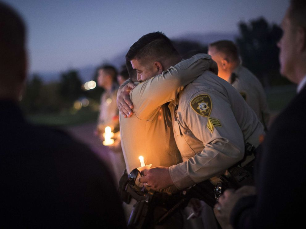 PHOTO: Sgt. Ryan Fryman, who was on the scene of the mass shooting, hugs a fellow officer during a vigil, Oct. 5, 2017 in Las Vegas for Police Officer Charleston Hartfield, who was killed when a gunman opened fire on a crowd attending a music festival.